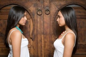 Identical indian twin sisters